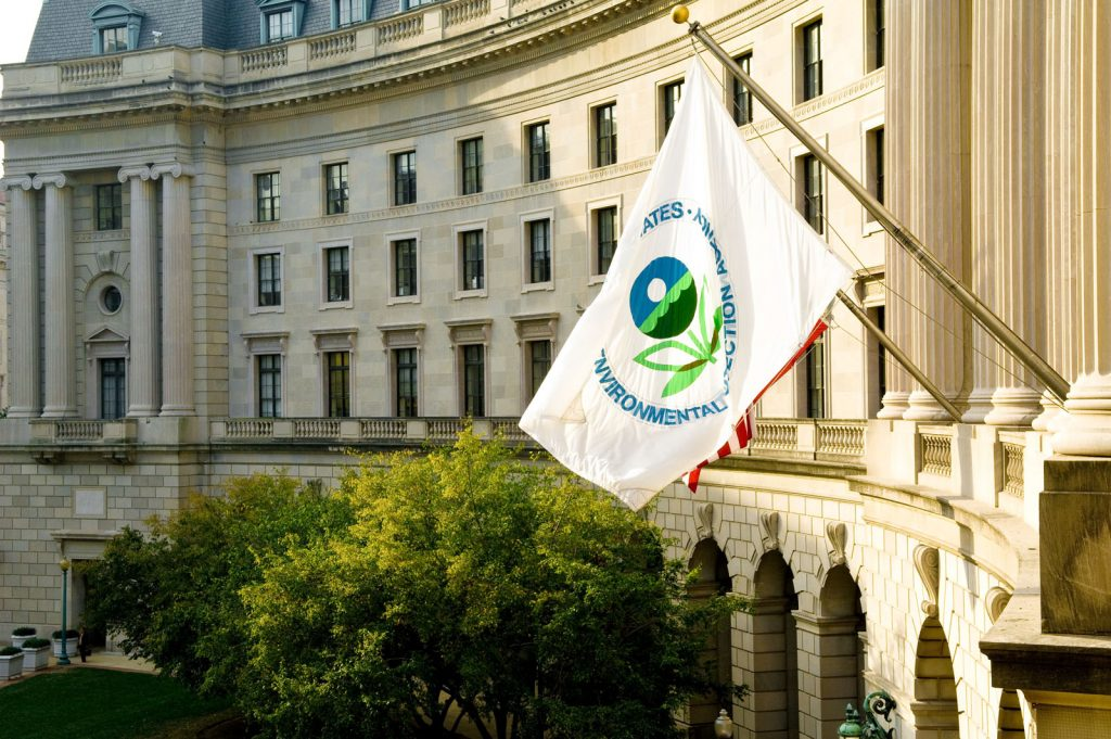 The EPA flag flying on the front of the EPA headquarters building