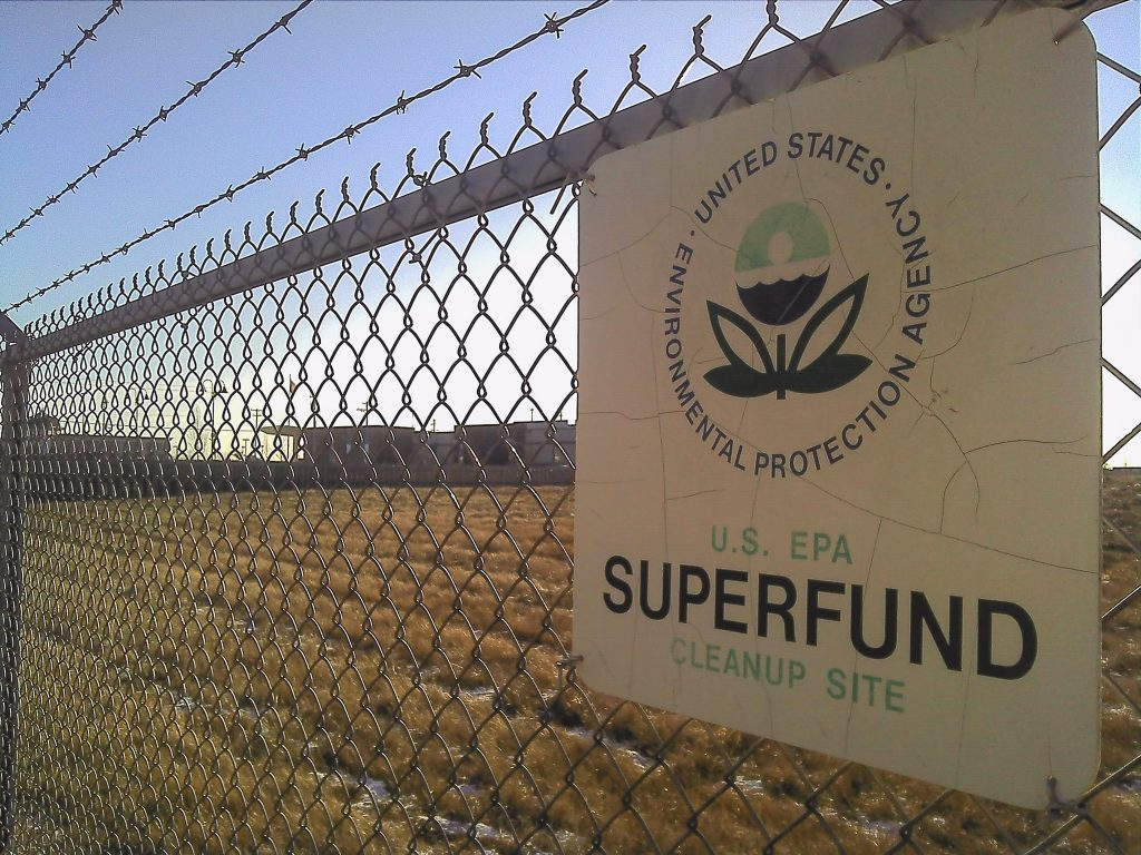 A EPA Superfund cleanup site sign on a chainlink fence